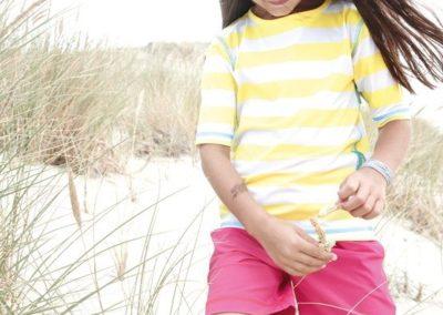 Kind in den Dünen