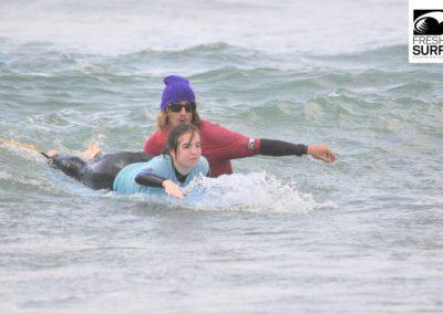 Surfcoach mit Kind