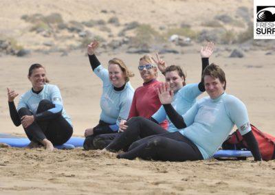 Surfgruppe winkt